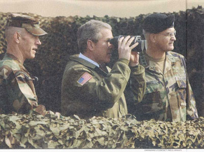 Bush looking through binoculars