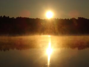 foggy sunrise on like